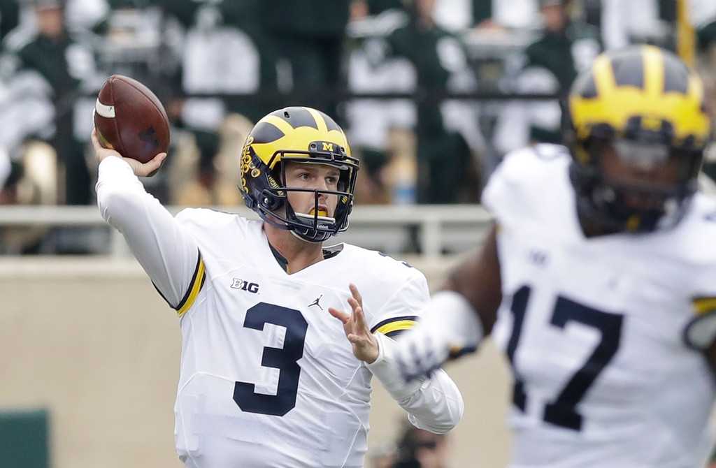 . Michigan quarterback Wilton Speight (3) throws a pass during the first half of an NCAA college football game against Michigan State, Saturday, Oct. 29, 2016, in East Lansing, Mich. (AP Photo/Carlos Osorio)