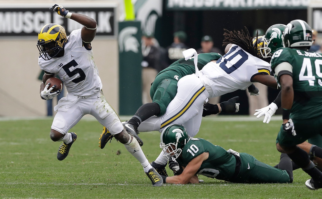 . Michigan linebacker Jabrill Peppers (5) returns a kickoff during the first half of an NCAA college football game against Michigan State, Saturday, Oct. 29, 2016, in East Lansing, Mich. (AP Photo/Carlos Osorio)