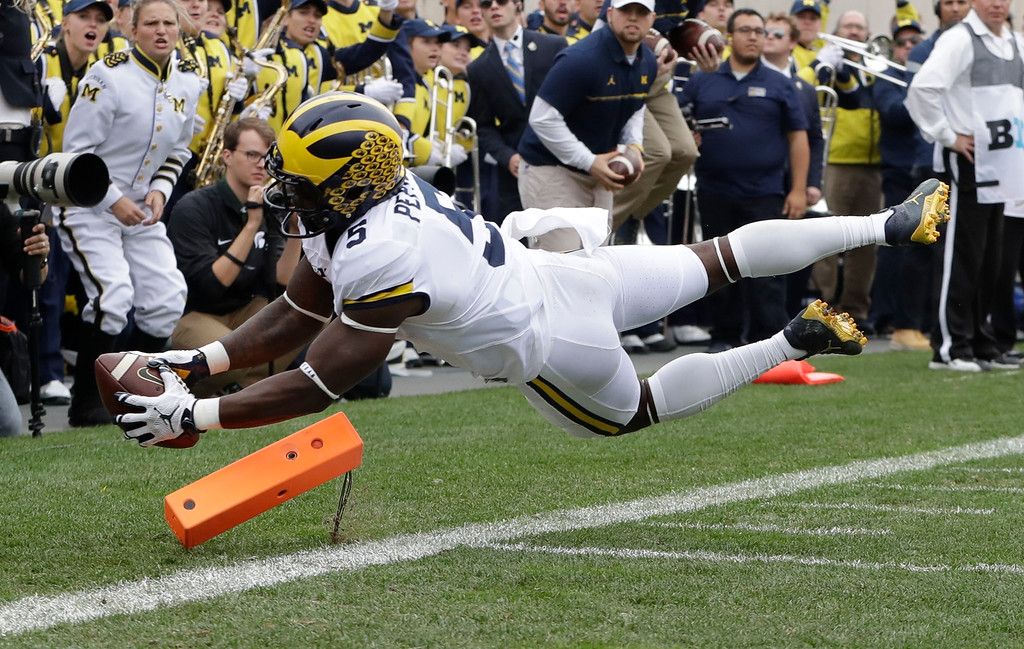 . Michigan\'s Jabrill Peppers falls into the end zone for a touchdown during the first half of an NCAA college football game against Michigan State, Saturday, Oct. 29, 2016, in East Lansing, Mich. (AP Photo/Carlos Osorio)