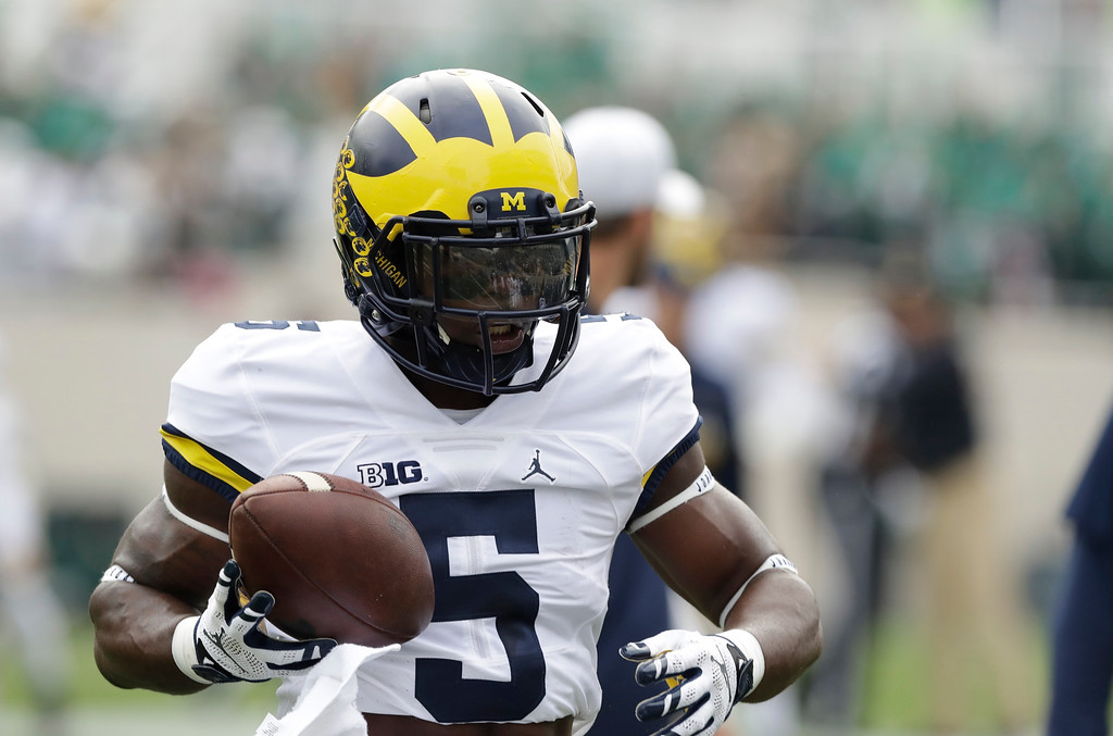 . Michigan\'s Jabrill Peppers makes a catch before the college football game against Michigan State, Saturday, Oct. 29, 2016, in East Lansing, Mich. (AP Photo/Carlos Osorio)