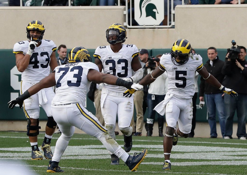 . Michigan linebacker Jabrill Peppers (5) celebrates after scoring on a safety with Michigan defensive tackle Maurice Hurst (73), during the second half of a college football game against Michigan State, Saturday, Oct. 29, 2016, in East Lansing, Mich. (AP Photo/Carlos Osorio)