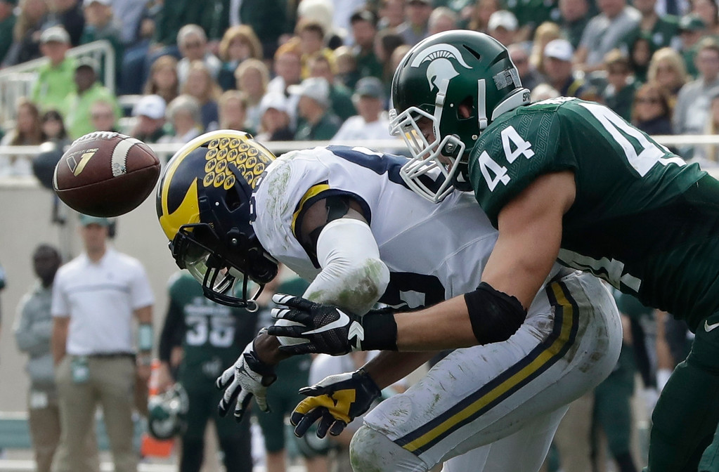 . Michigan State safety Grayson Miller (44) breaks up a pass intended for Michigan wide receiver Jehu Chesson during the second half of a college football game, Saturday, Oct. 29, 2016, in East Lansing, Mich. (AP Photo/Carlos Osorio)