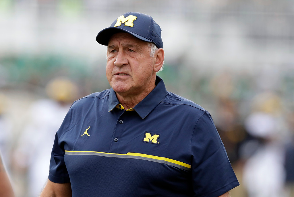 . Michigan defensive line coach Greg Mattison watches during warmups of a college football game against Michigan State, Saturday, Oct. 29, 2016, in East Lansing, Mich. (AP Photo/Carlos Osorio)