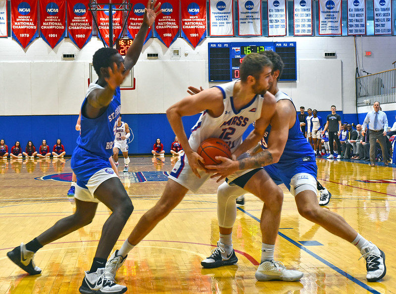 Looking for a open player is UML #12- Josh Gantz in this game with St. Francis Brooklyn Terriers. SUN/ David H. Brow