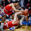 UMass Lowell's Matt Harris trys to gain possession of the ball from Hartford's J.R. Lynch (13) and Jason Dunne. SUN/Caley McGuane