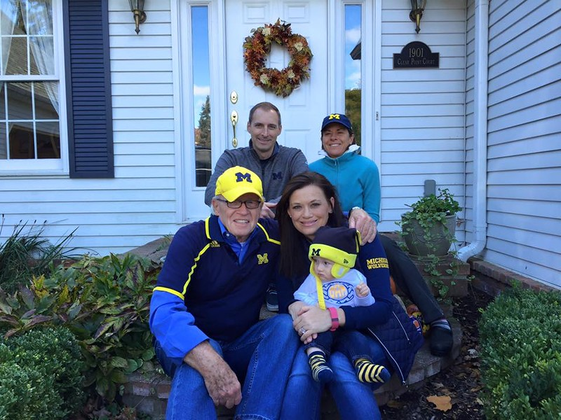 . Michigan graduates and siblings Amber Selke, Wesley Selke and Linzi Selke Adkins --pictured with their dad, Doug Selke, and Dane Adkins before attending the homecoming game last Saturday. Photo submitted  by Shelia Selke
