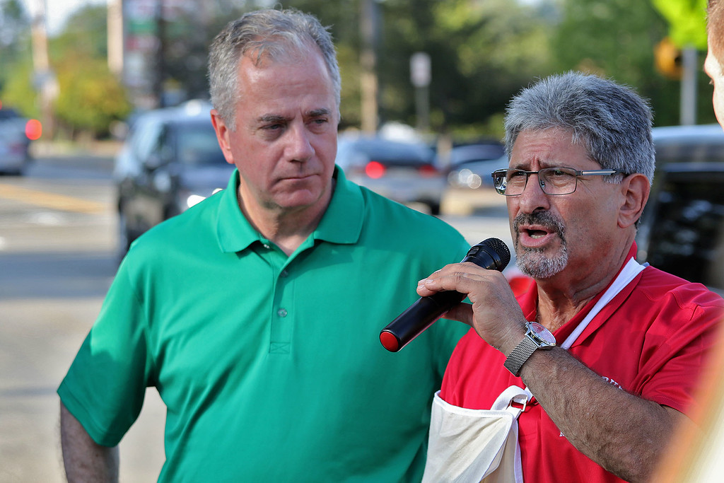 . Nurses, patients, and elected officials held a protest of the closure of some of UMass Memorial\'s local services outside of UMass Memorial HealthAlliance-Clinton Hospital in Leominster on Wednesday night. Clinton State Rep. Harold Naughton listens to Fitchburg Mayor Stephen DiNatale as he addresses these closers at the protest. SENTINEL & ENTERPRISE/JOHN LOVE