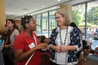 Elizabeth Barnum, director of International Student and Scholar Services, meets students and scholars at the 2016 International Welcome Social.   Photo by Donn Young