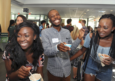 EASE mentors enjoy a laugh along with their Ben and Jerry's ice cream at the UNC Global International Welcome Social.  Photo by Donn Young