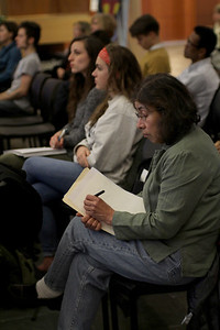 Lecture attendee takes notes while listening to Holliday's lecture.  Photo by Molly Irwin