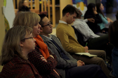 Thupten Norbu, associate director of Carolina Asia Center at UNC-Chapel Hill, listens along with other lecture attendees.