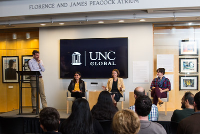 """Niklaus Steiner (left), director of the Center for Global Initiatives, moderates a discussion between (from left to right) Laura Villa-Torres, Hannah Gill and Katy Clune '15 M.A., three project researchers and producers who worked on projects featured in the """"Migration Narratives"""" exhibition."""