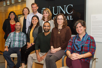 """Producers of and participants in the """"Migration Narratives"""" panel discussion pose for a photograph.  Left to right: Felicia Arriaga, doctoral candidate at Duke University; Bahij '17; Hannah Gill, director of the Latino Migration Project and New Roots/Nuevas Raíces; Niklaus Steiner, director the Center for Global Initiatives; Laura Villa Torres, bilingual outreach assistant with New Roots/Nuevas Raíces; Ingrid Smith, manager of global events and exhibitions; Zubair '18; Katie Bowler Young, director of Global Relations; Katy Clune '15 M.A."""