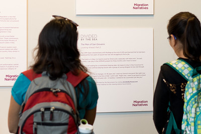 Guests learn about the stories of asylum-seekers in Italy from the Divided by the Sea project.