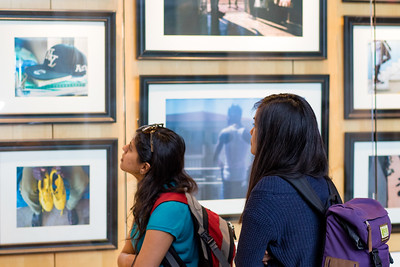 Guests view photos from the project Divided by the Sea.