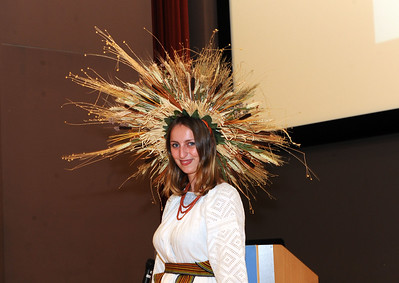 Anastasiia Kostenko, member of the Ukrainian Association of North Carolina,  models an interpretation of a Ukrainian harvest wreath headpiece.  Photo by Donn Young.