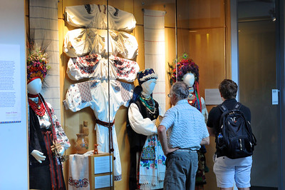 """Opening reception attendees observe the display of traditional Ukrainian embroidery, or """"vyshyvka,"""" in the """"Image of Ukraine"""" exhibition at the FedEx Global Education Center.  Photo by Donn Young."""