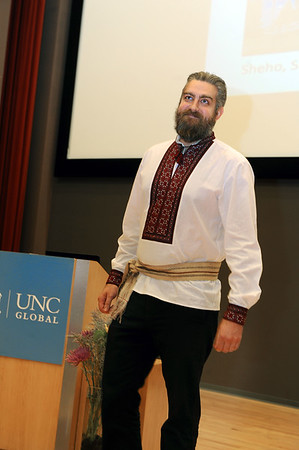Trevor Erlacher, teaching assistant professor in the Department of History, demonstrates how vyshyvka  is portrayed in men's clothing during the fashion demonstration of Ukrainian embroidery.  Photo by Donn Young.
