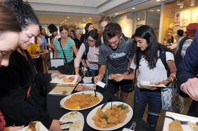 Attendees enjoy the reception featuring a variety of traditional Ukrainian food.  Photo by Donn Young.