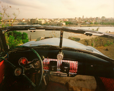 View of Havana from El Cristo de Casa Blanca, Looking South from Ricardo Moya Silveira's 19511 Chevrolet - Alex Harris  Photo print - 1998  Gift of Charles Weinraub