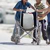 Jordan. Children transporting water in a wheelchair in Za'atari.