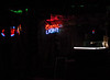 Tiki Bar at night with only neon lights on.