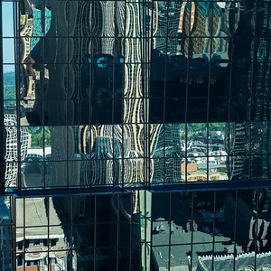 Reflections on modern glass building, Minneapolis, Hennepin County, Minnesota, USA