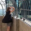 Woman looking at city view through railings, Minneapolis, Hennepin County, Minnesota, USA