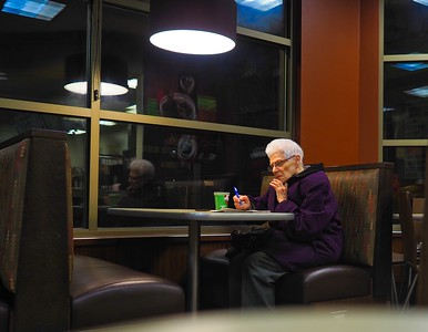 woman doing crosswords at Tim Hortons