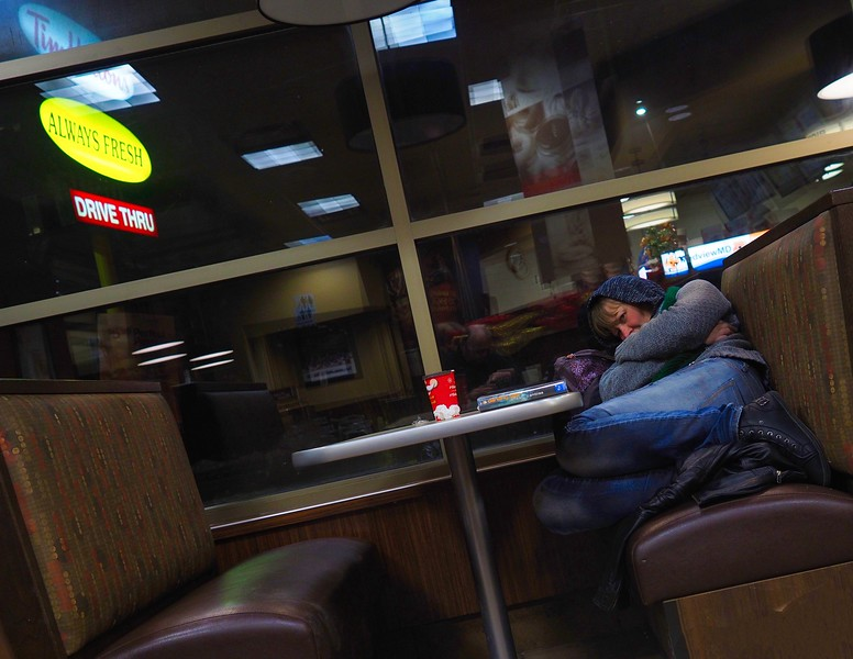 woman asleep at Tim Hortons