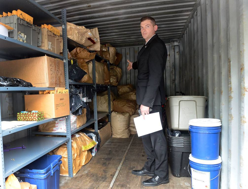 . Tania Barricklo-Daily Freeman    Det. Lt. Dirk Budd of the Ulster County Sheriff\'s Office points to the corner of a trailer holding 300 pounds of marijuana, processed and unprocessed, that was seized from several homes in Marlboro that were allegedly grow houses.
