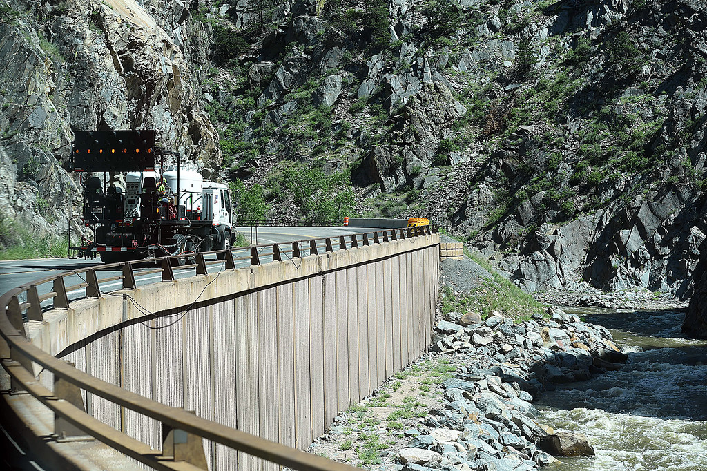 . A striping truck paints lines on U.S. 34 in the narrows of the Big Thompson Canyon Monday, May 21, 2018, in preparation of the road re-opening this Thursday west of Loveland. (Photo by Jenny Sparks/Loveland Reporter-Herald)