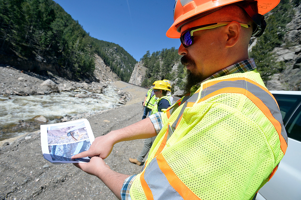 . James Usher, project director with CDOT, talks about wor crews did on an area of U.S. 34 near where a land slide occured during the flood, during a tour of the Big Thompson Canyon on Monday, May 21, 2018, west of Loveland. (Photo by Jenny Sparks/Loveland Reporter-Herald)