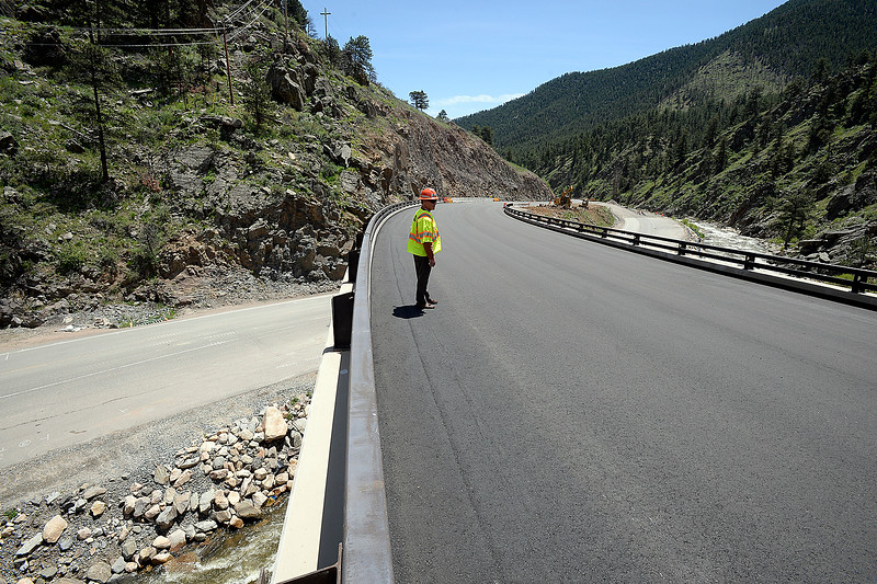 Johnny Olson, transportation director for CDOT, stands on a new bridge on U.S. 34 above the old exhisiting road at the horseshoe curve in the Big Thompson Canyon as he talks about the new portion of the road, on Monday, May 21, 2018, west of Loveland. (Photo by Jenny Sparks/Loveland Reporter-Herald)