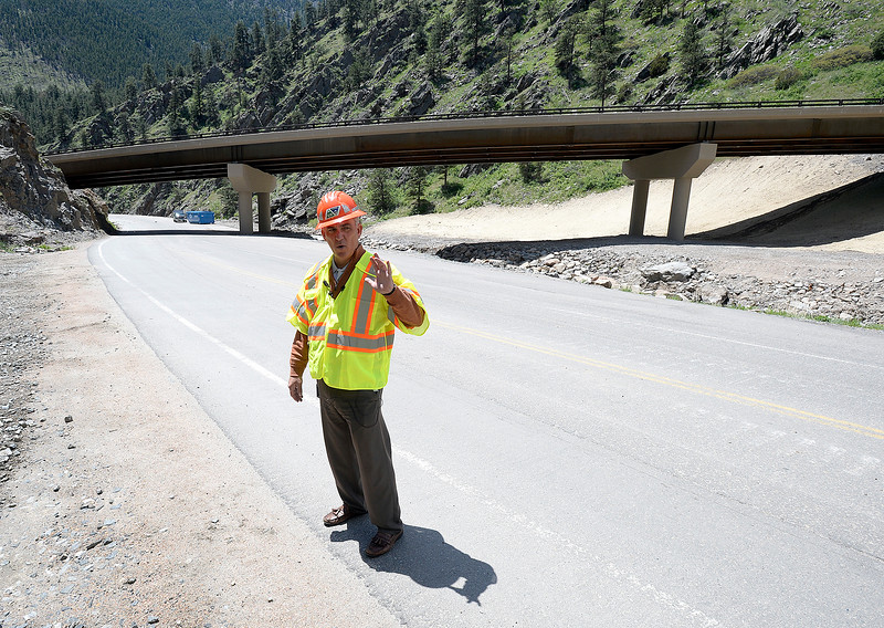 Johnny Olson, transportation director for CDOT, stands on an old portion of U.S. 34 at the horseshoe curve in the Big Thompson Canyon as he talks about the new portion of the road, the bridge behind him on Monday, May 21, 2018, west of Loveland. (Photo by Jenny Sparks/Loveland Reporter-Herald)