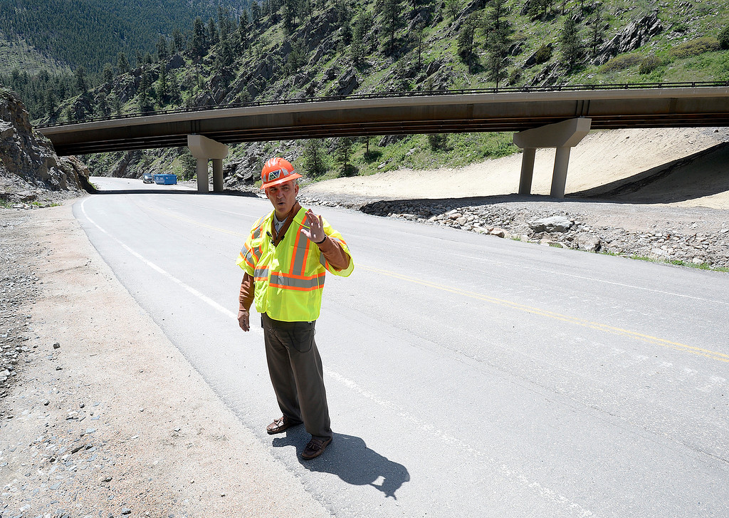 . Johnny Olson, transportation director for CDOT, stands on an old portion of U.S. 34 at the horseshoe curve in the Big Thompson Canyon as he talks about the new portion of the road, the bridge behind him on Monday, May 21, 2018, west of Loveland. (Photo by Jenny Sparks/Loveland Reporter-Herald)