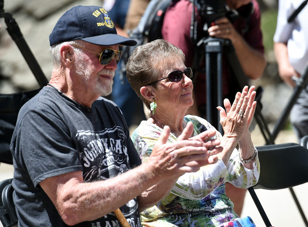 . Barb and Andy Anderson, long-time Big Thompson Canyon residents, applaud Thursday, May 31, 2018, during an event to celebrate the re-opening of U.S. 34 west of Loveland.  (Photo by Jenny Sparks/Loveland Reporter-Herald)