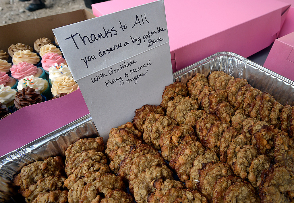 """. Cookies with a \""""Thank You\"""" note made by Big Thompson resident Mary Myers sit on a table Thursday, May 31, 2018, during an event to celebrate the re-opening of U.S. 34 west of Loveland. Myers said she has made thousands of cookies for construction crews working on the road the last couple of years.  (Photo by Jenny Sparks/Loveland Reporter-Herald)"""