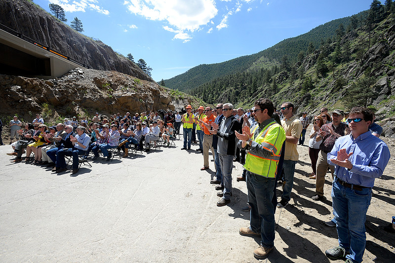 People, including Big Thompson Canyon residents and Kiewit employees, gather to celebrate the completion of U.S. 34. Thursday, May 31, 2018, west of Loveland. (Photo by Jenny Sparks/Loveland Reporter-Herald)