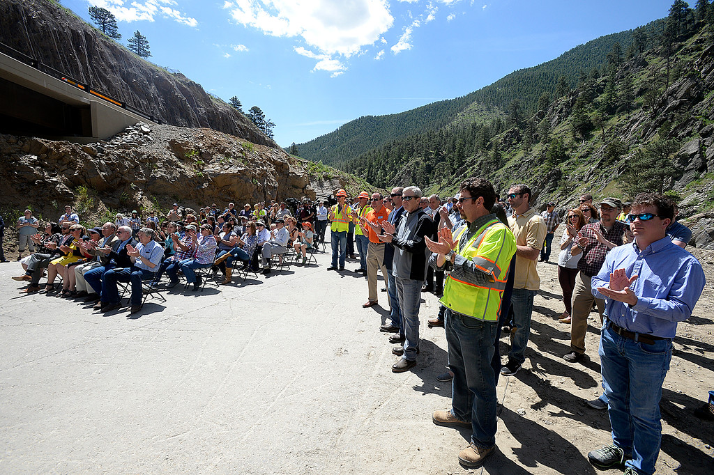 . People, including Big Thompson Canyon residents and Kiewit employees, gather to celebrate the completion of U.S. 34. Thursday, May 31, 2018, west of Loveland. (Photo by Jenny Sparks/Loveland Reporter-Herald)