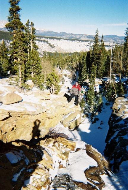 Matt standing over the frozen Alberta Falls