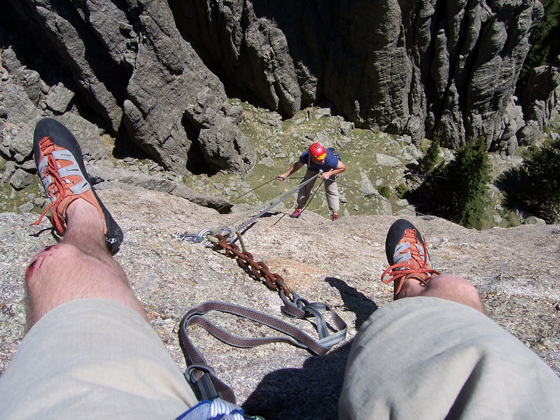 Brit deals with the ropes on rappel, which have each gone around a different side of the Tooth, while I enjoy the view
