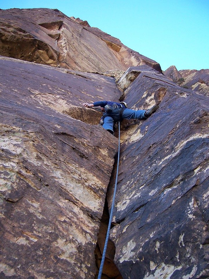 Blake leads the first pitch of Triassic Sands, 10c.  The 2nd, crux pitch is visible in the upper left.