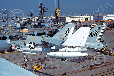 A-7USN 00161 A Vought A-7E Corsair II USN 157471 is lifted by a crane onto the USS Coral Sea 11-1979 military airplane picture by Michael Grove, Sr