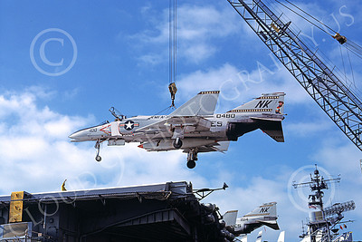 F-4USMC 00345 A McDonnell Douglas F-4N Phantom II USMC 150480 VMFA-323 DEATH RATTLERS is crane lifted onto the USS Coral Sea NK code NAS North Island 11-1975 military airplane picture by Tom Chee