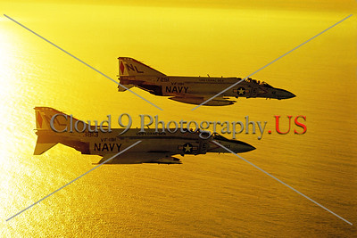 F-4II-USN-VF-191 002 Two flying McDonnell Douglas F-4J Phantom IIs USN jet fighters VF-191 SATAN'S KITTENS USS Coral Sea NL tail code military airplane picture by Robert L Lawson     Dwt
