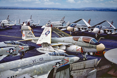EA-6B-USN-VAQ-132 001 A Grumman EA-6B Prowler, USN electronics jammer carrier based airplane, 158808, VAQ-132 SCORPIONS, on a crowded USS Independence flight deck, 11-1975 Portsmouth, military airplane picture by Stephen W  D  Wolf   CCC_0185   Dt
