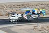 E-2USN 00259 A sharkmouth Grumman E-2 Hawkeye USN VAW-112 GOLDEN HAWKS USS John C  Stennis taxis at NAS Fallon 1-2015 military airplane picture by Peter J Mancus