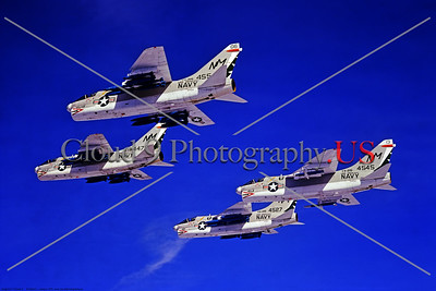 A-7USN-VA-215 008 Four flying Vought A-7B Corsair IIs USN attack jets, VA-215 BARN OWLS, USS Oriskany, NM code, armed with training ordnance, by Robert Lawson via Stephen W  D  Wolf collection    CCC_0306     Dt