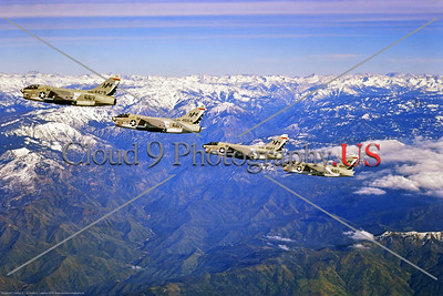 A-7USN-VA-215 004 Four Vought A-7B Corsair IIs USN attack jets, VA-215 BARN OWLS, USS Oriskany, NM code, flying over snow capped High Sierras, by Robert Lawson via Stephen W  D  Wolf collection    CCC_0290     Dt